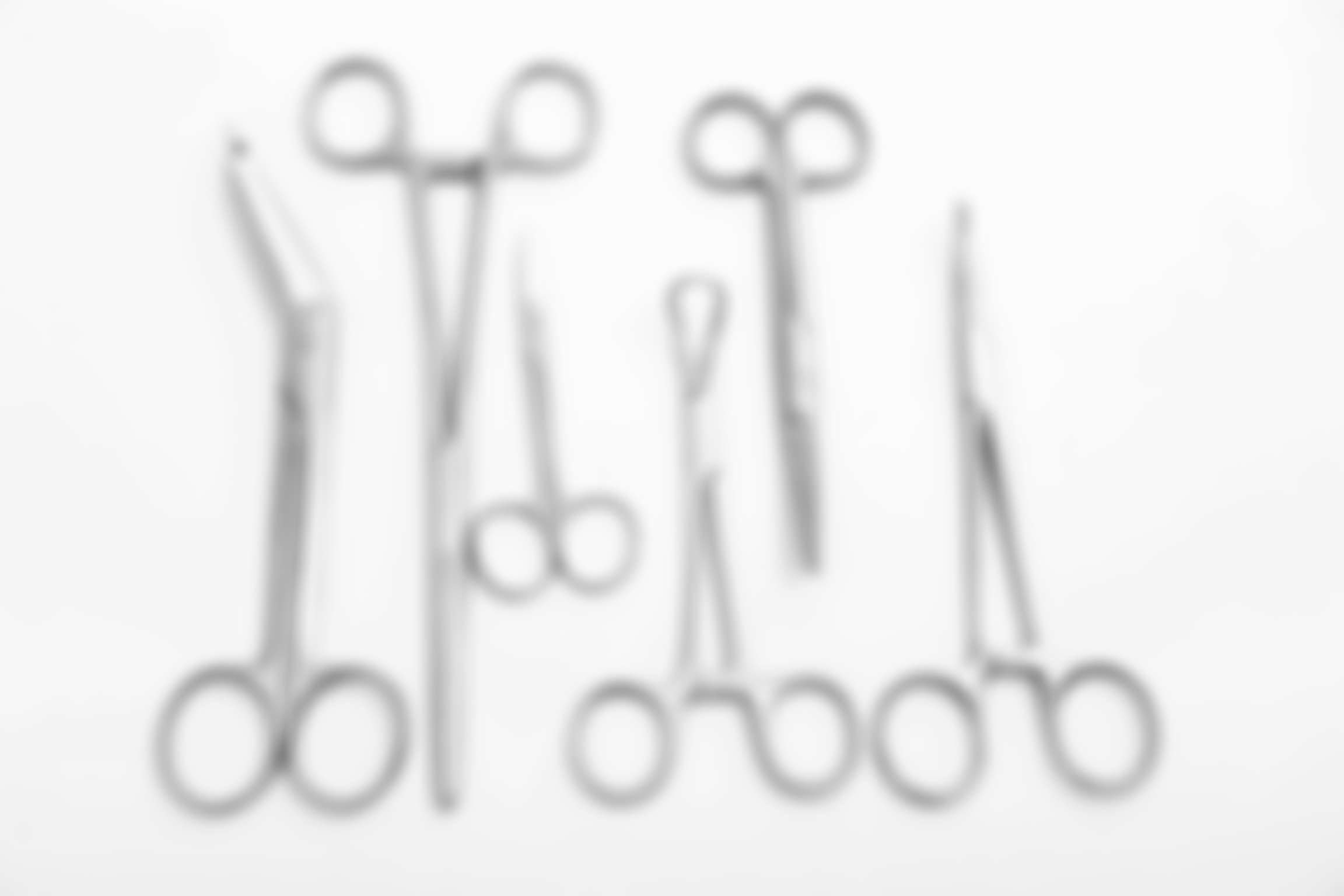 Flat lay of medical instruments on white background